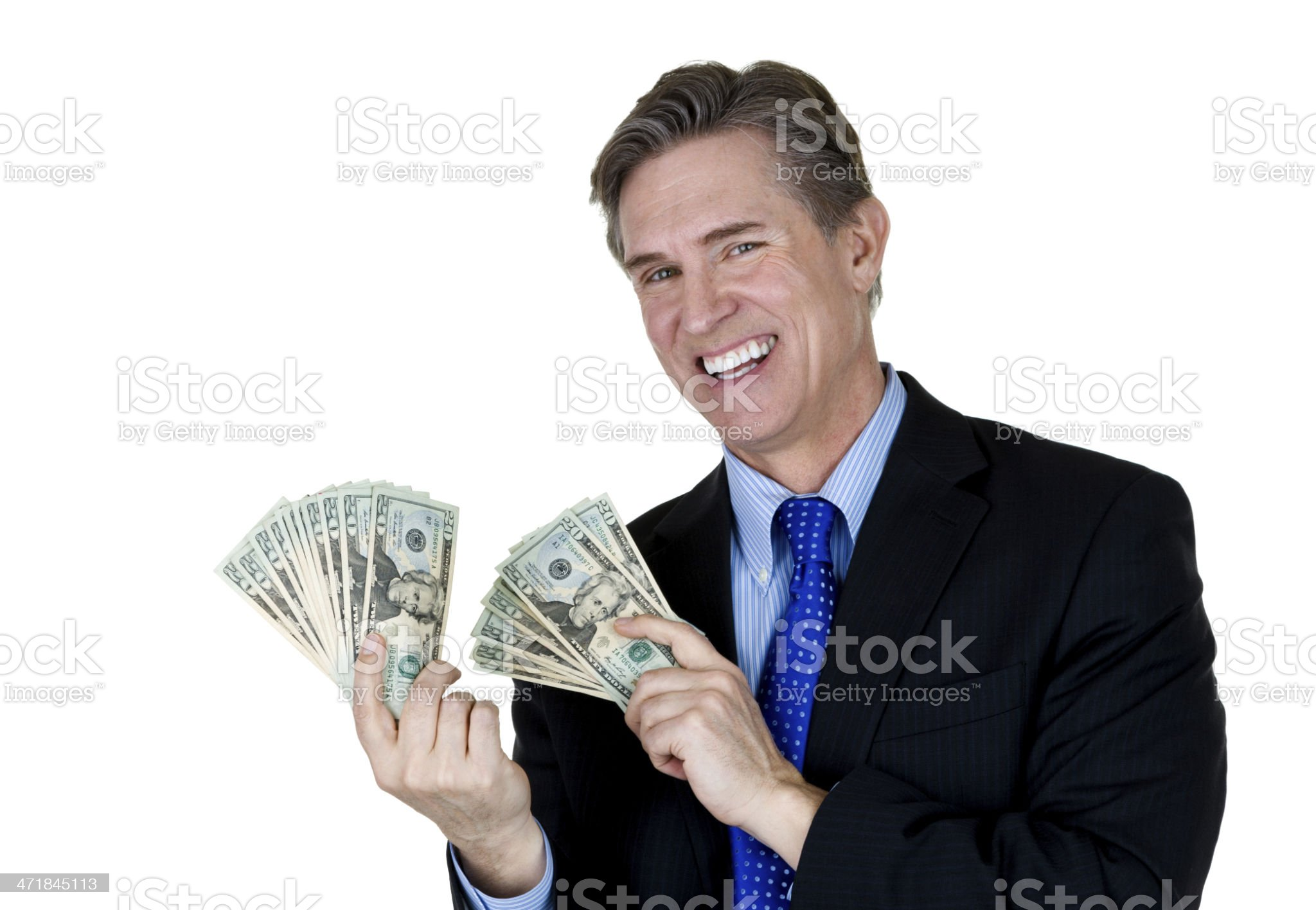 Man wearing a suit and holding money royalty-free stock photo