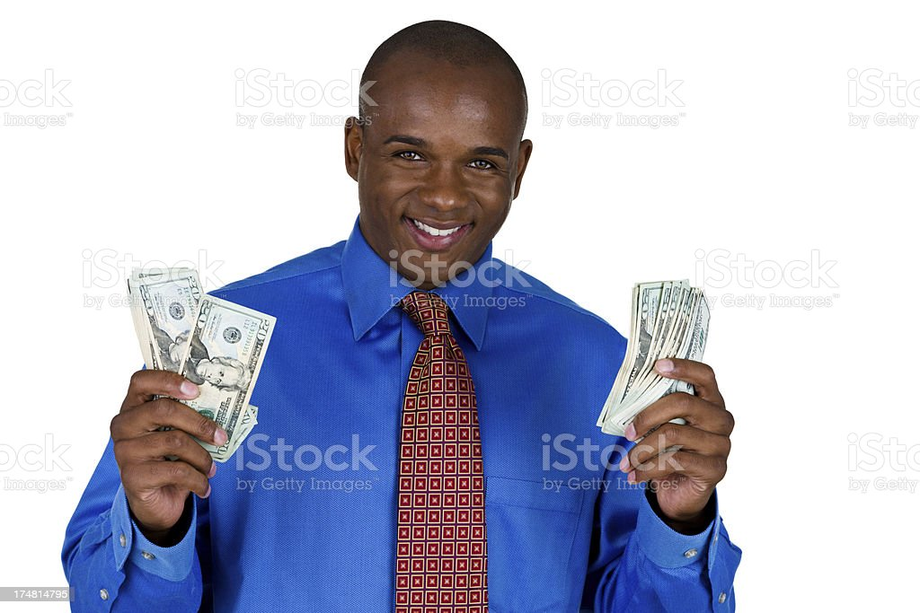Man wearing a suit holding money royalty-free stock photo