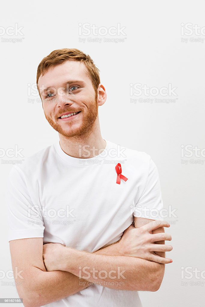 Man wearing aids awareness ribbon stock photo