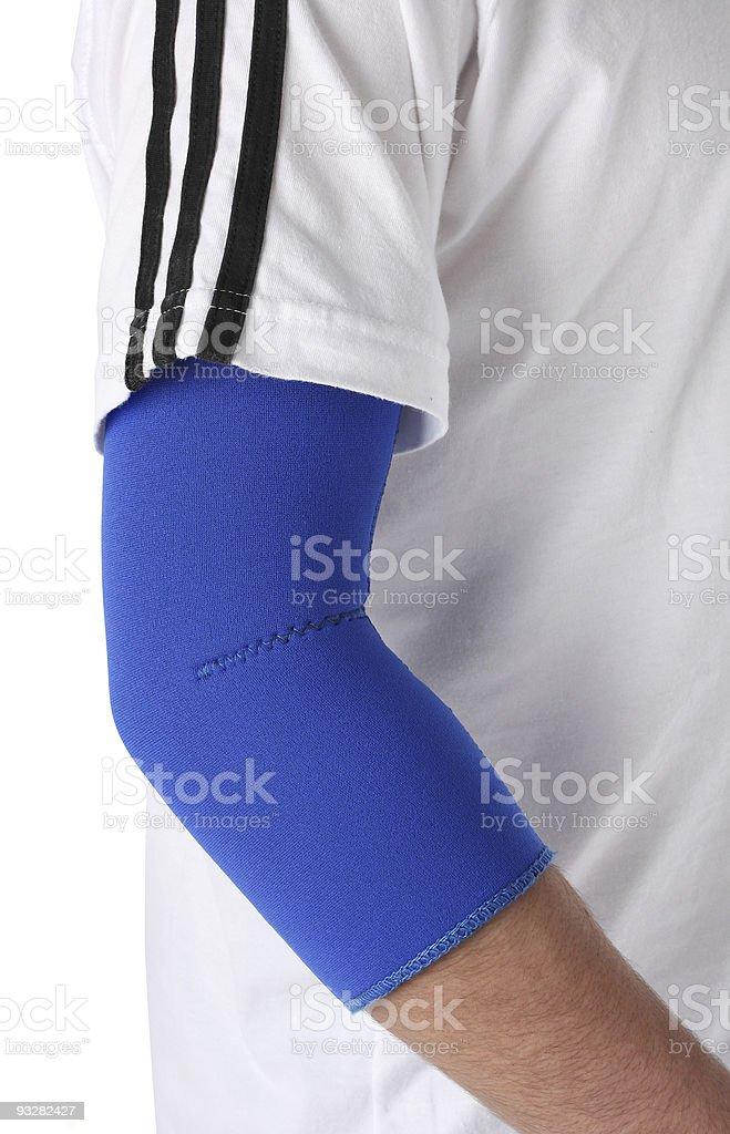 Man wearing an elbow brace stock photo