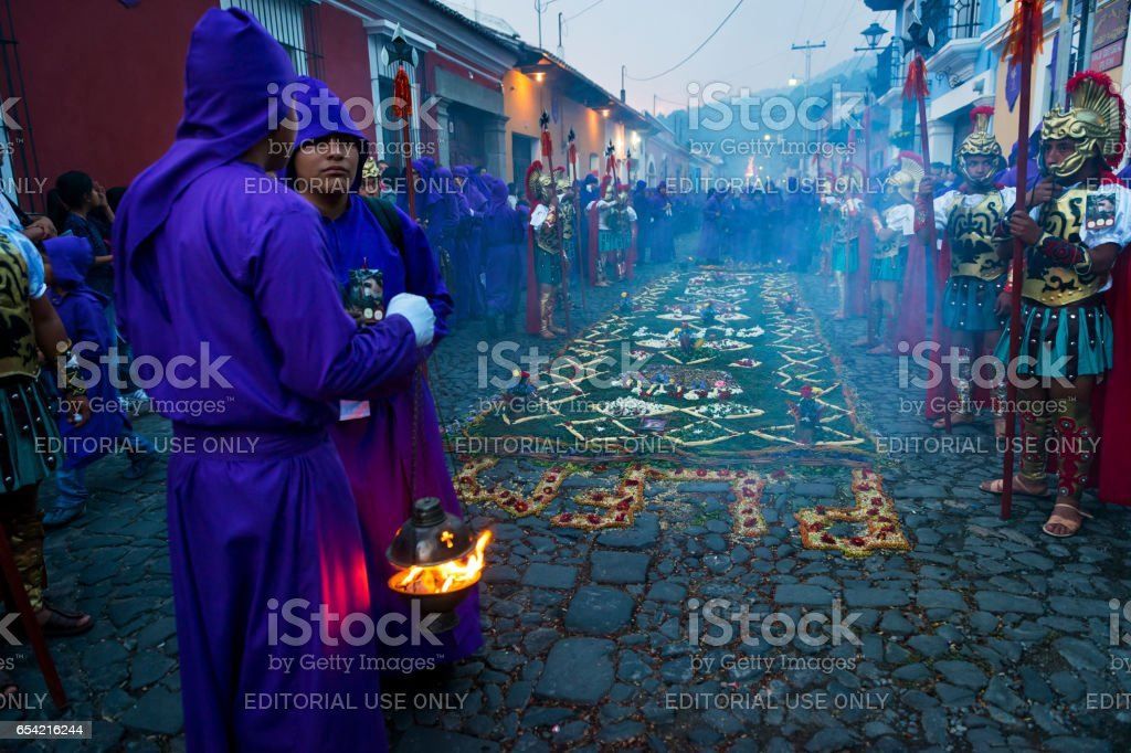 Man wearing ancient Roman military clothes and purple robes in a procession during the Easter celebrations, in the Holy Week, in Antigua, Guatemala. stock photo