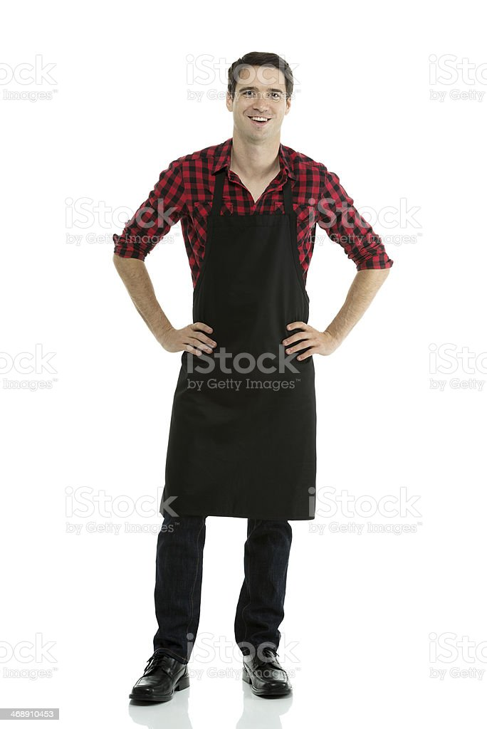 Man wearing apron with arms crossed stock photo
