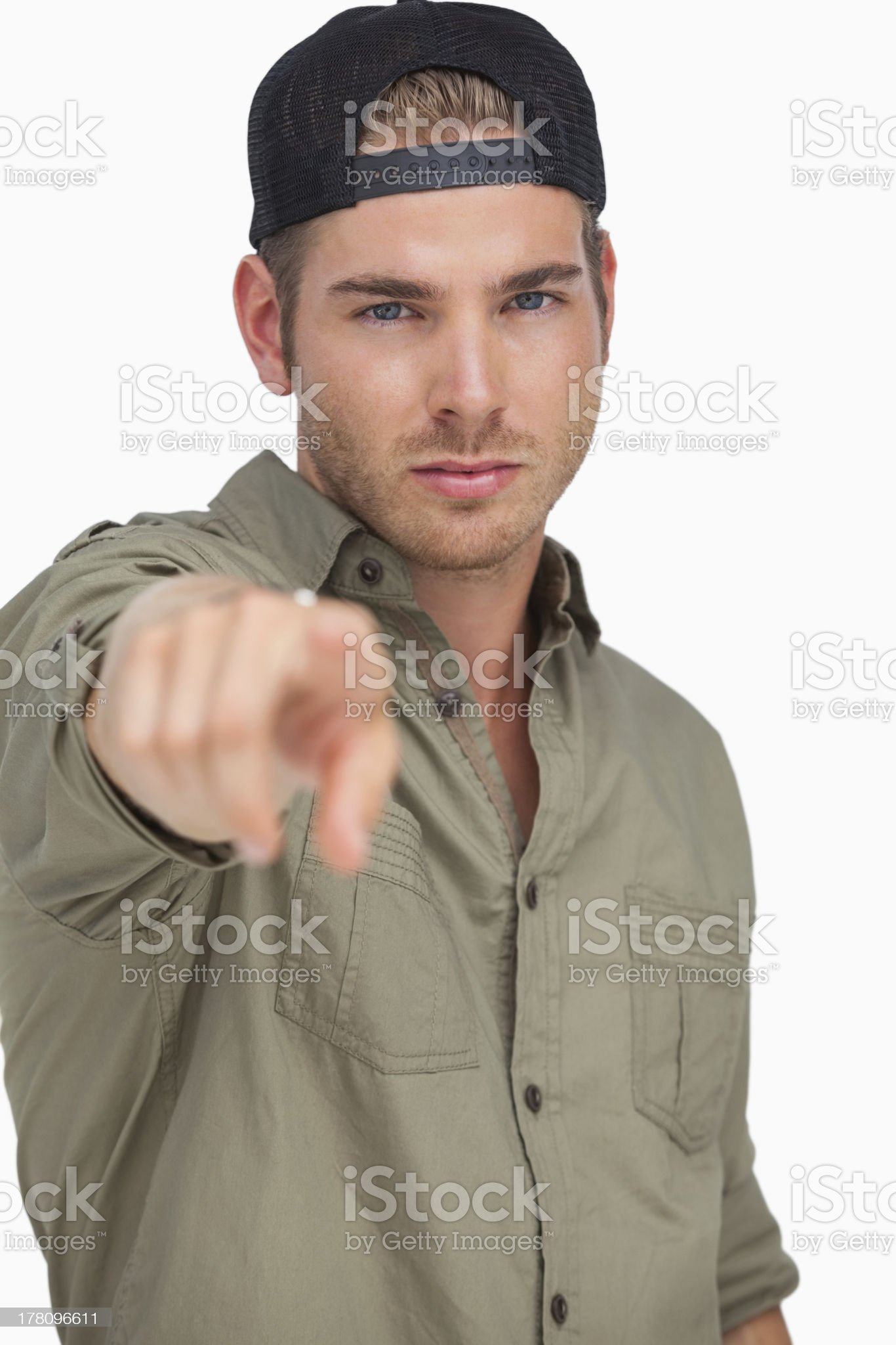 Man wearing baseball hat backwards and pointing royalty-free stock photo