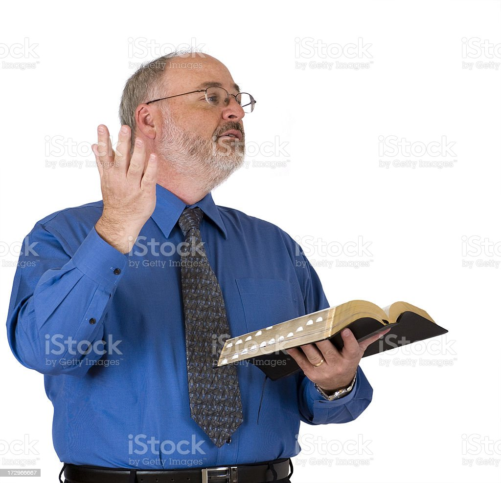 Man wearing blue preaching with a Bible. royalty-free stock photo