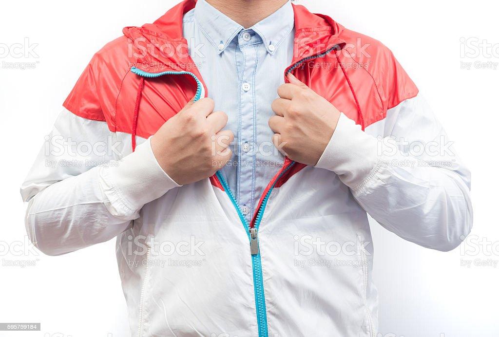 man wearing blue shirt and windbreaker jacket full zip hoodie stock photo