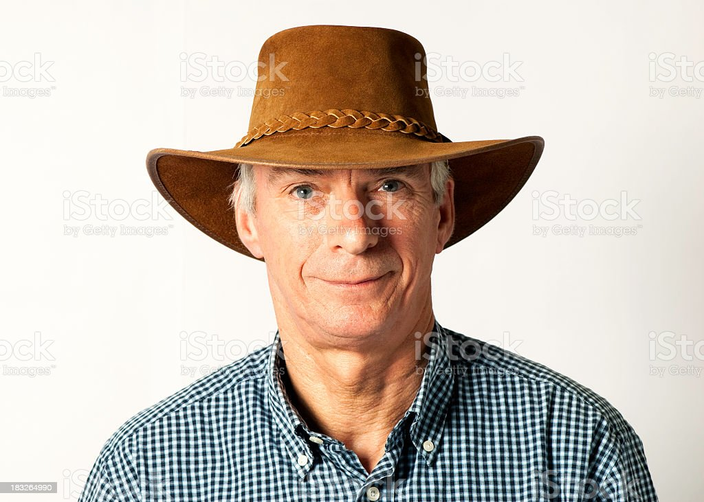 Man wearing cowboy hat and smiling stock photo
