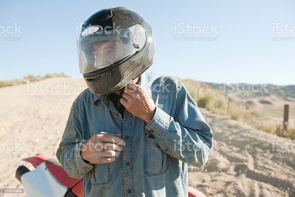 Man wearing crash helmet stock photo