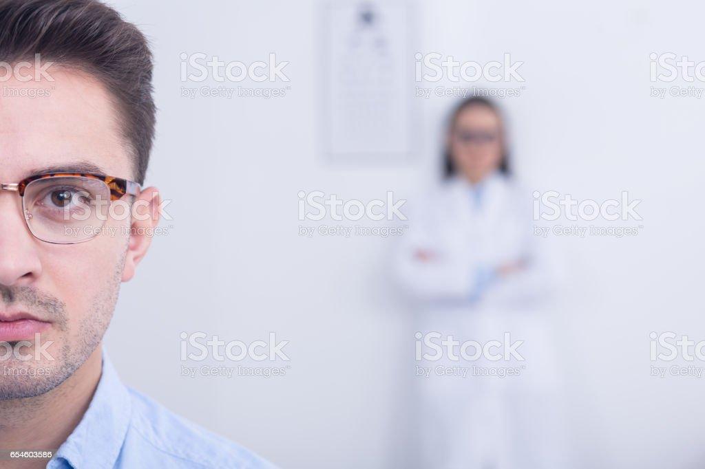 Man wearing designer eyeglasses stock photo