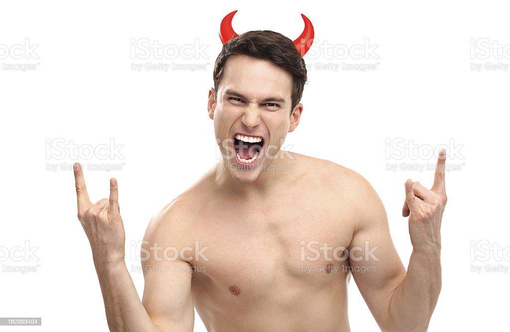Man wearing devil horns royalty-free stock photo