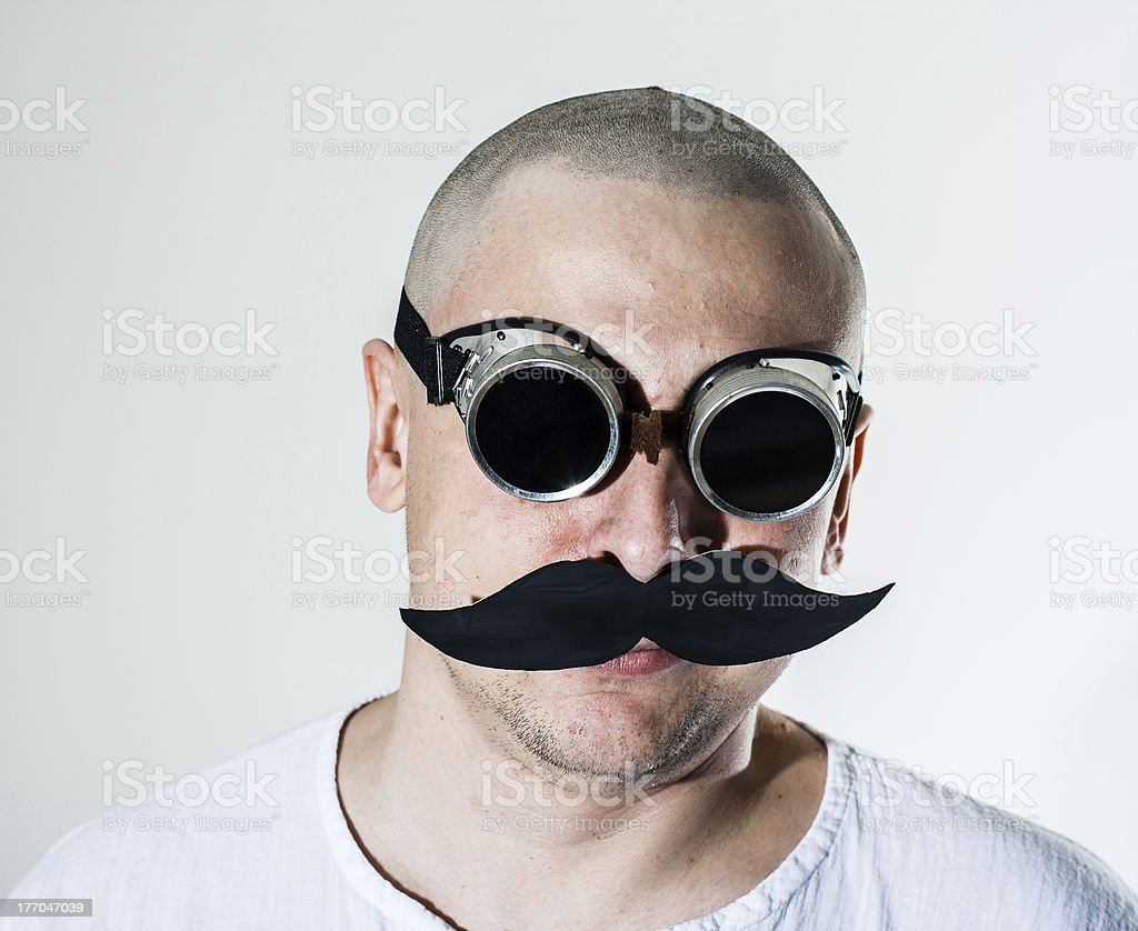 Man wearing false moustache and goggles stock photo