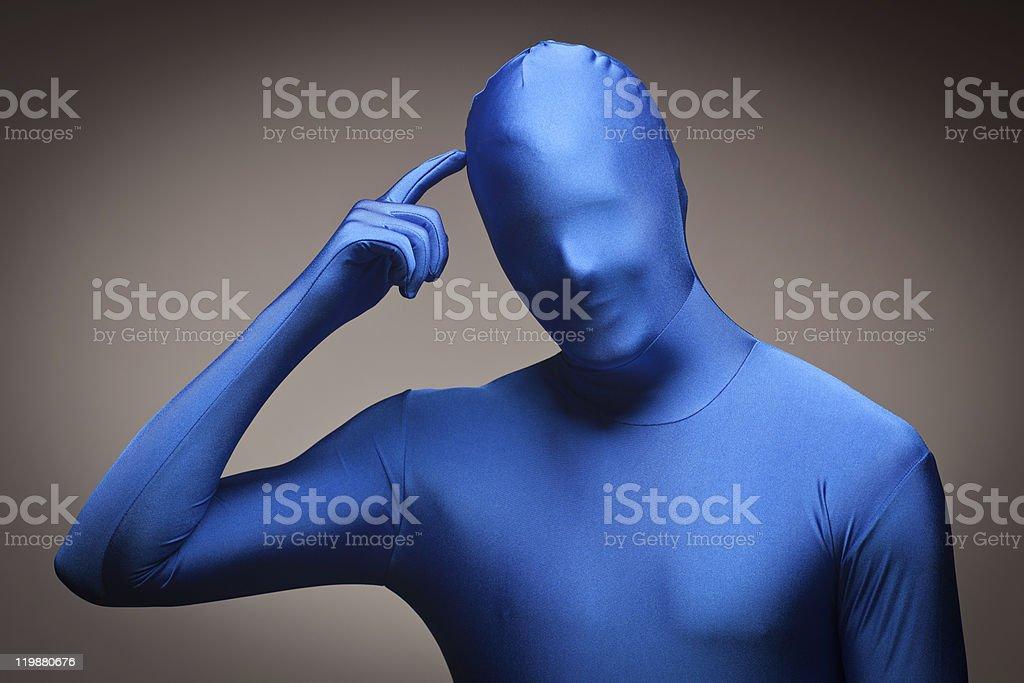 Man Wearing Full Blue Nylon Bodysuite Scratching Head stock photo