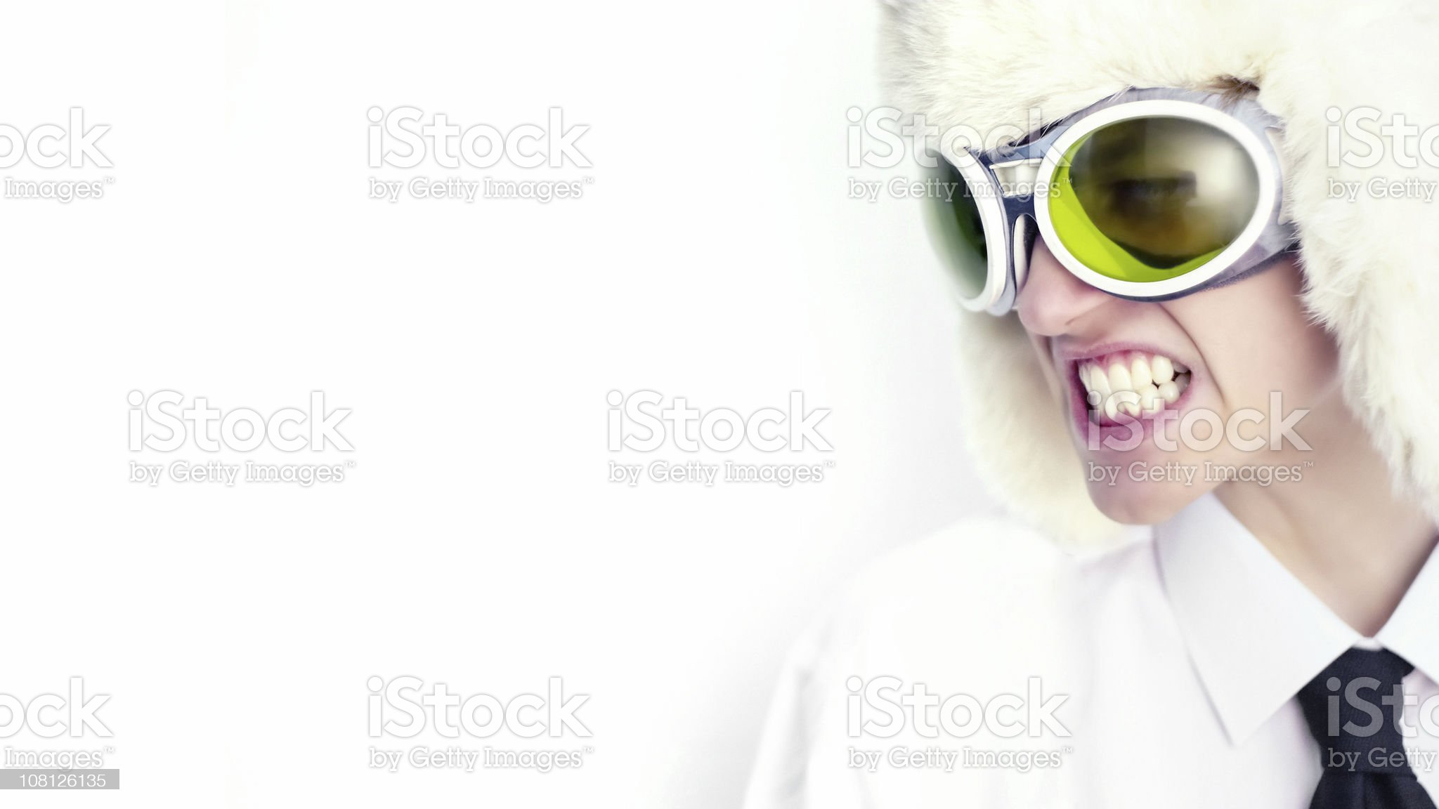 Man Wearing Fur Hat and Green Goggles royalty-free stock photo