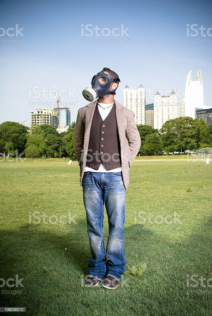 Man Wearing Gas Mask in Park royalty-free stock photo