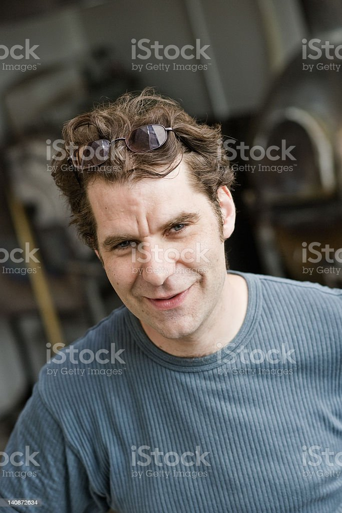 Man wearing glasses on his head stock photo