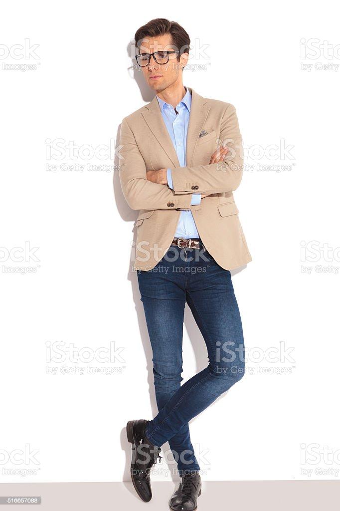 man wearing glasses posing in white studio stock photo