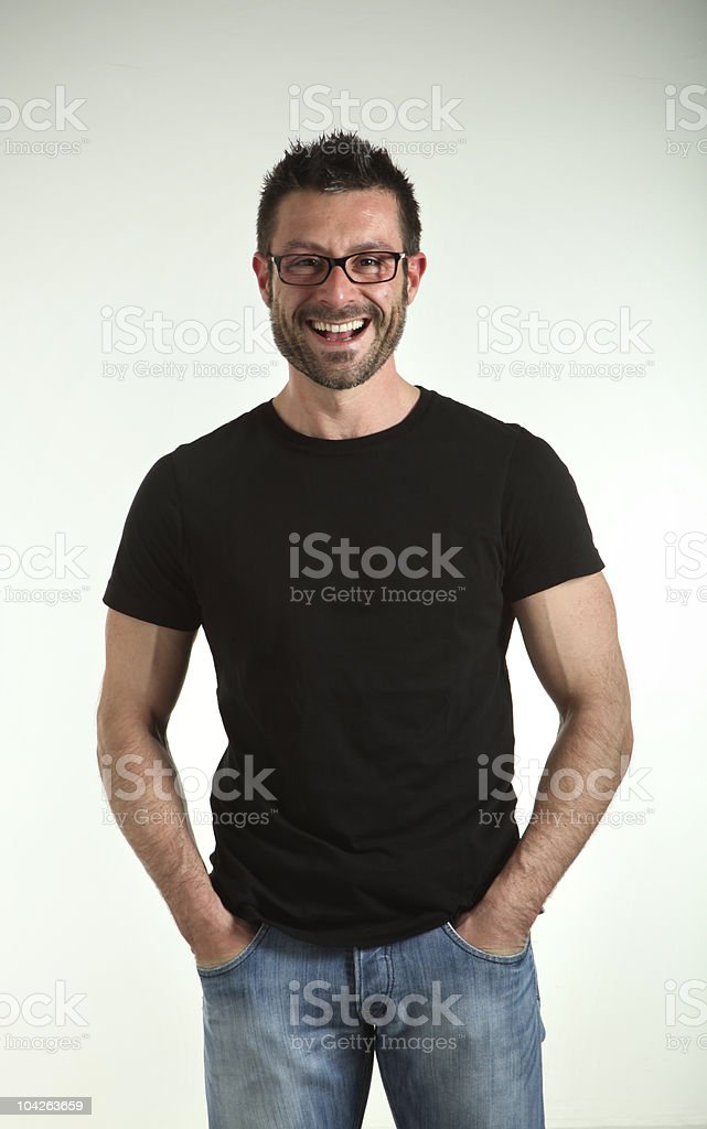 Man wearing glasses with hands in pockets royalty-free stock photo