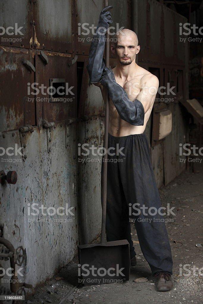 Man wearing gloves holding a shovel royalty-free stock photo