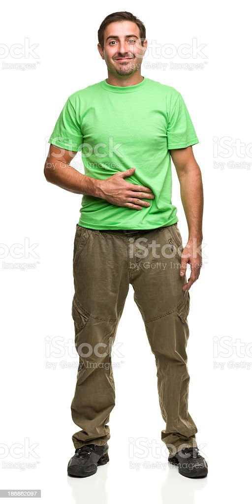 Man wearing green T-shirt with his hand on his belly stock photo
