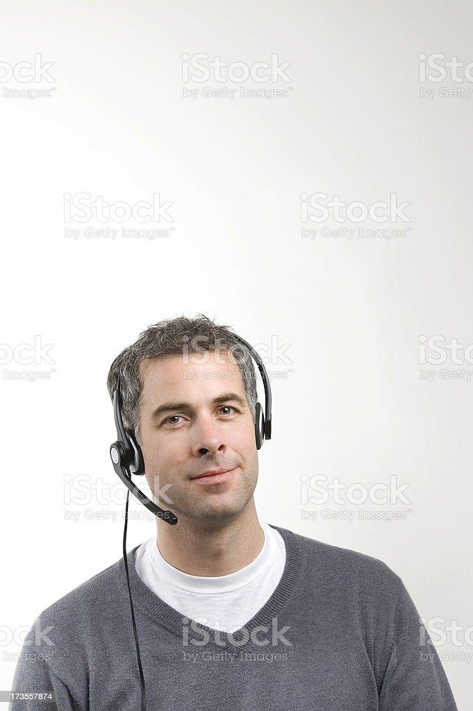 Man wearing headset stock photo