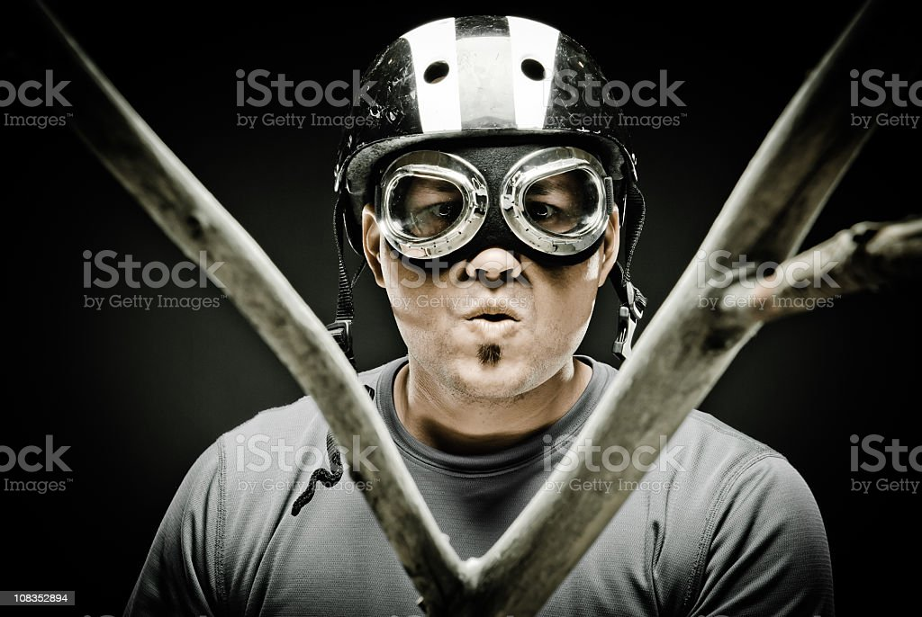 Man wearing helmet and goggles stock photo