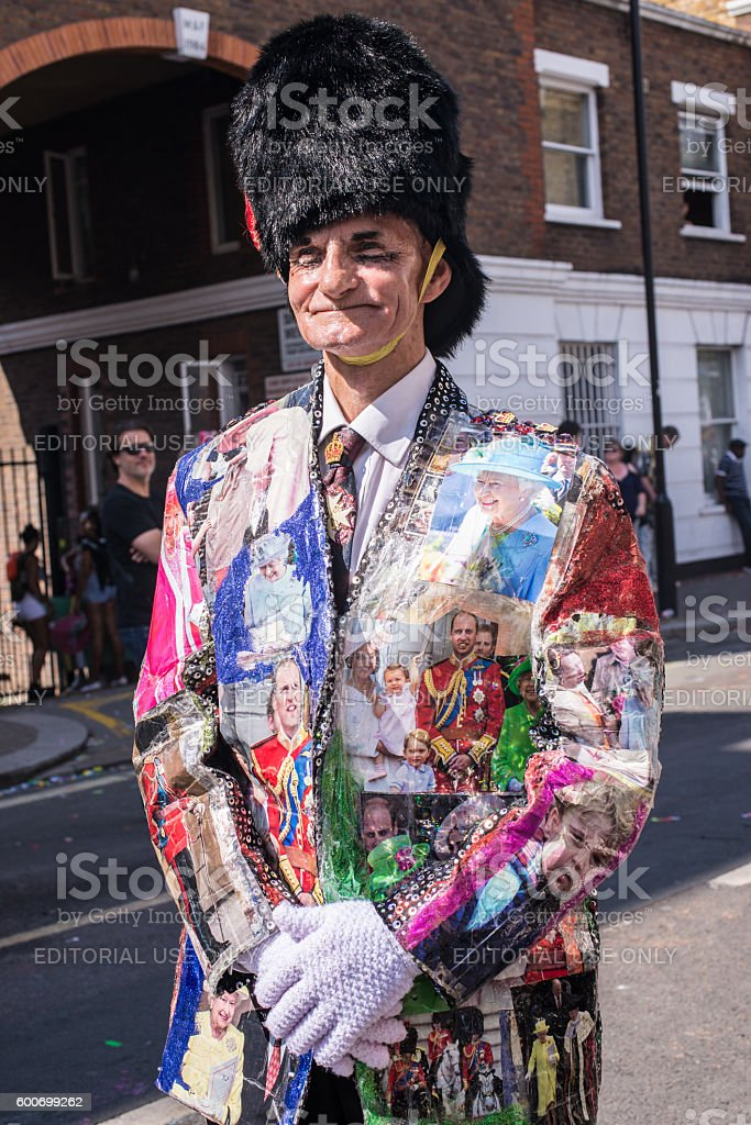 Man wearing jacket with pictures of Queen and Royal Family stock photo