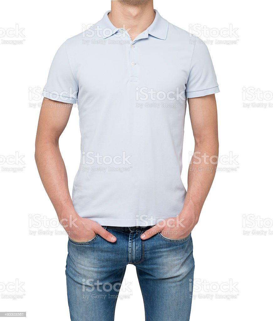 Man wearing light blue polo shirt and denims. stock photo