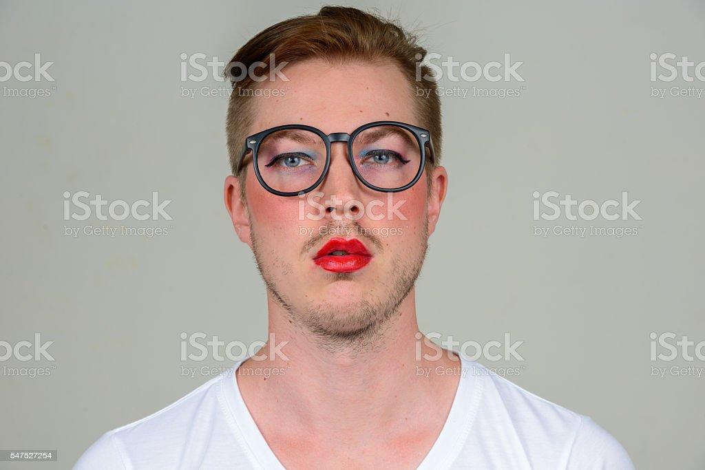 Man wearing make up stock photo