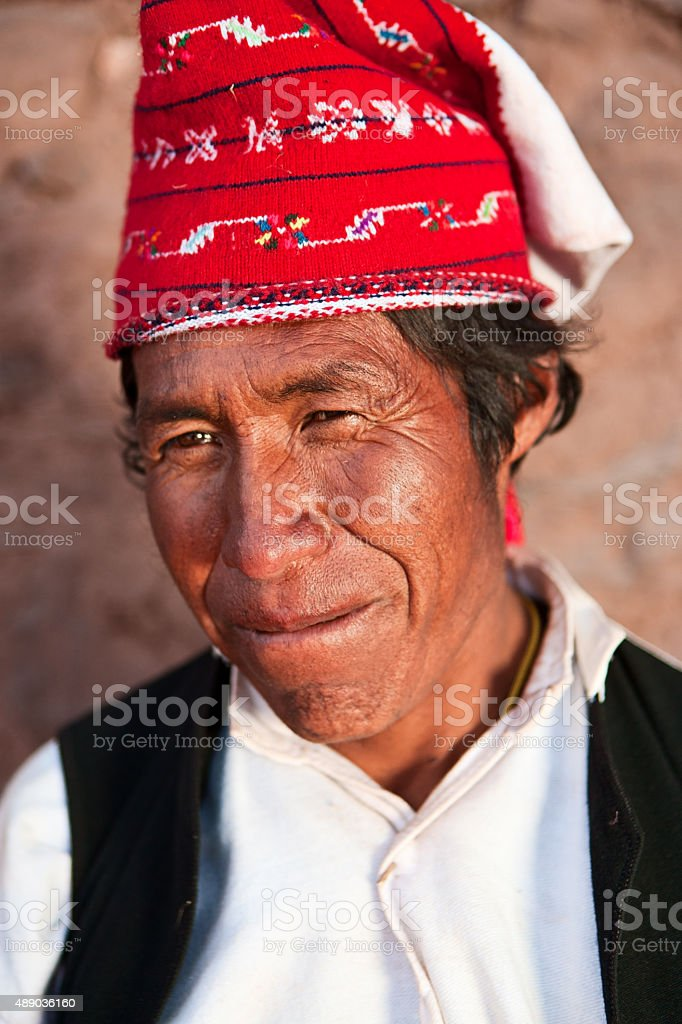Man wearing national costume on Taquile Island in Peru stock photo