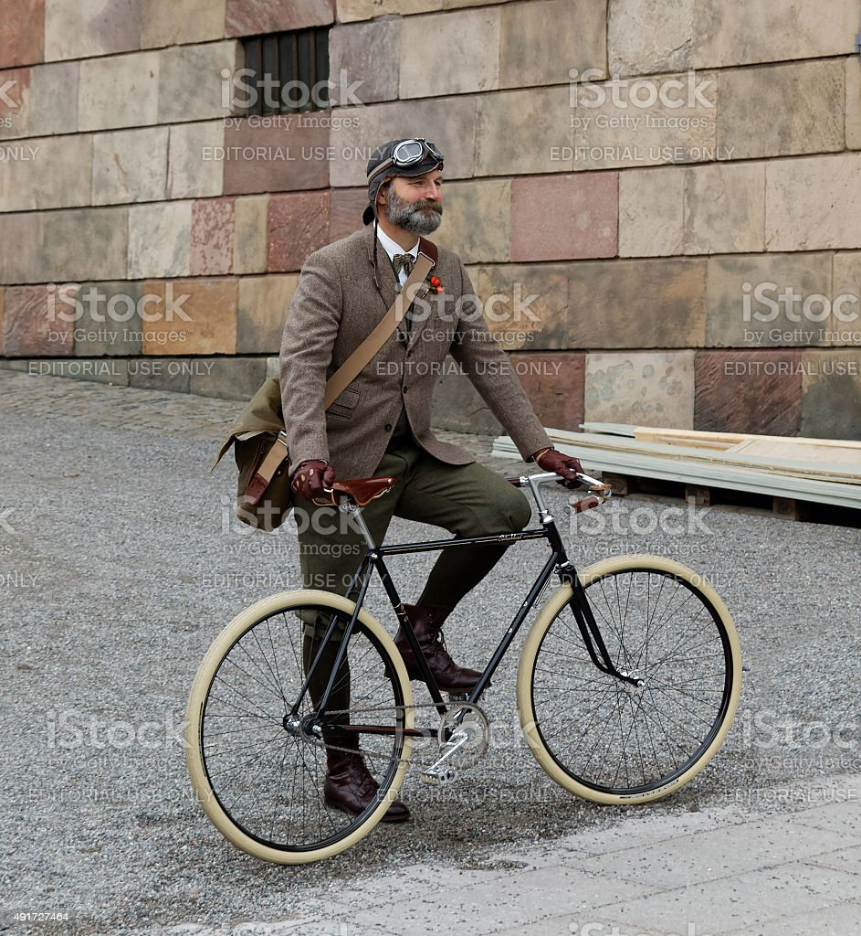 Man wearing old fashioned tweed clothes and bicycle stock photo