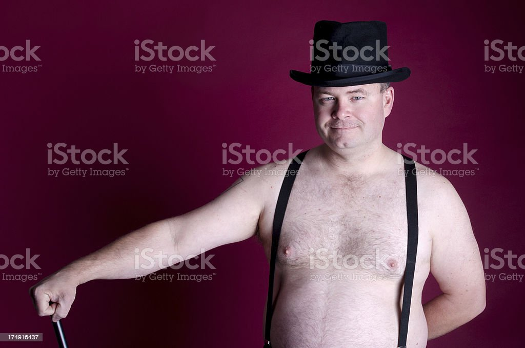 Man wearing only top hat and suspenders with cane. royalty-free stock photo