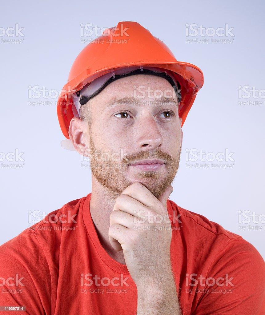 Man Wearing Orange Safety Helmet Thinking royalty-free stock photo
