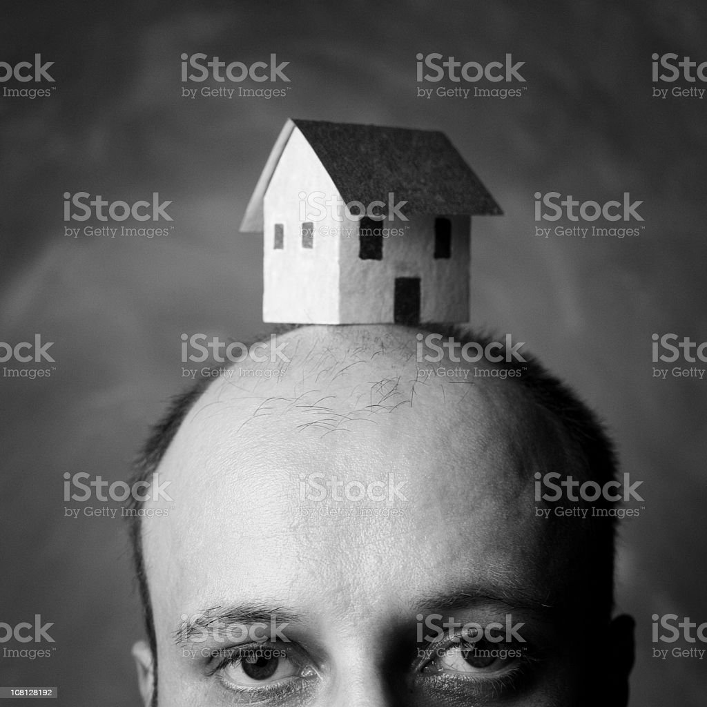 Man Wearing Paper House on Head, Black and White royalty-free stock photo