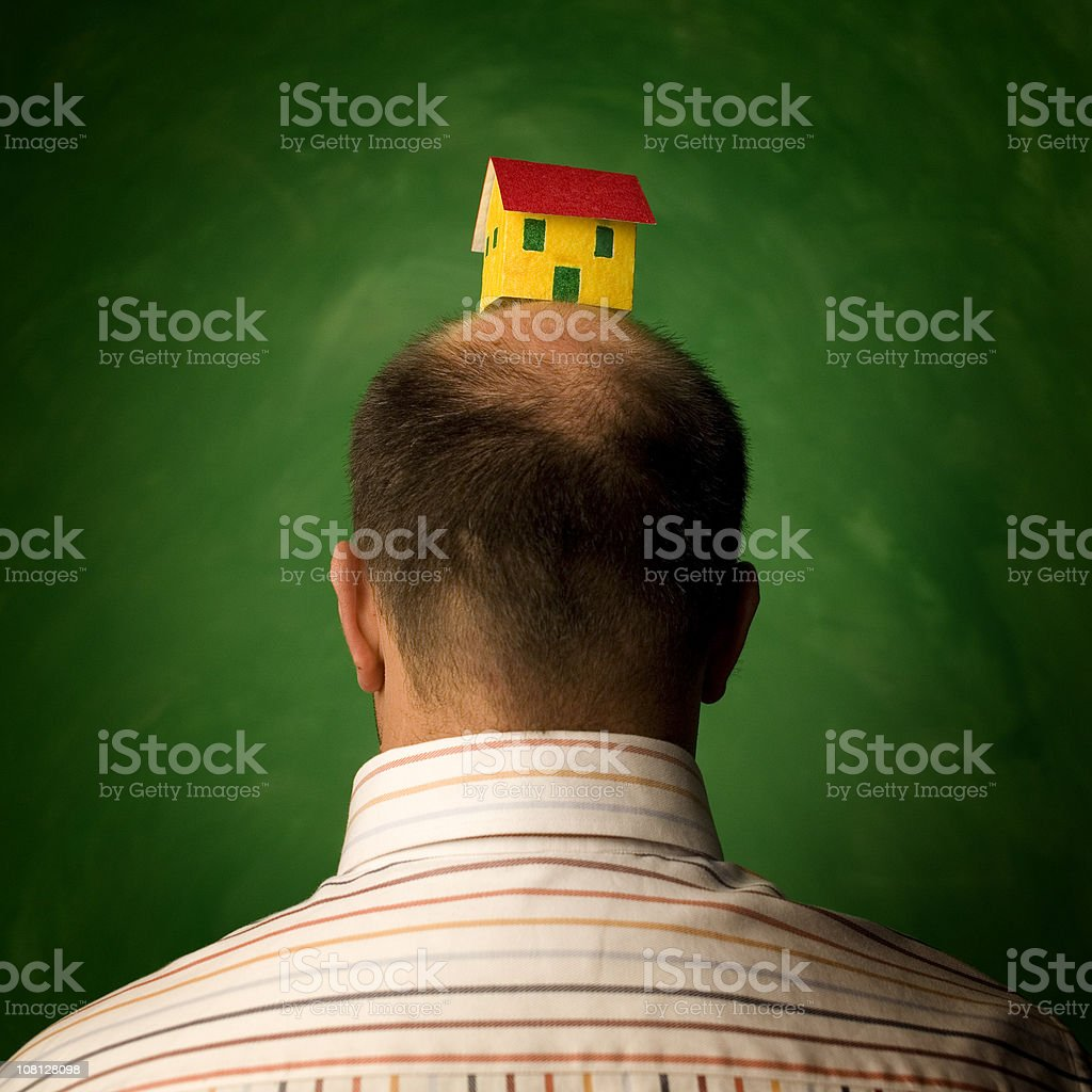 Man Wearing Paper House on Head royalty-free stock photo