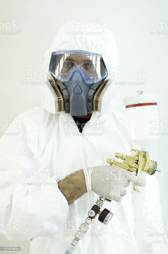 Man Wearing Protective Mask and Suit in Automotive Painting Chamber royalty-free stock photo