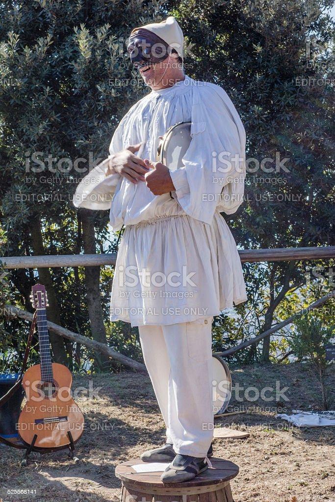 Man wearing Pulcinella Mask Clothes stock photo
