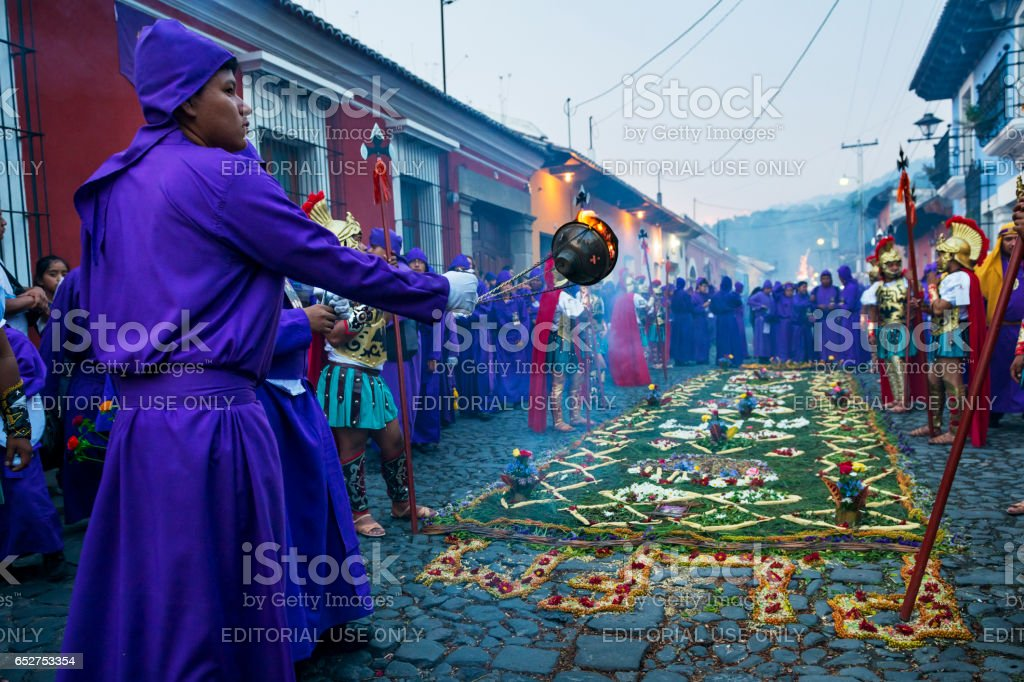 Man wearing purple robes and ancient Roman military clothes during the Easter celebrations, in the Holy Week, in Antigua, Guatemala. stock photo