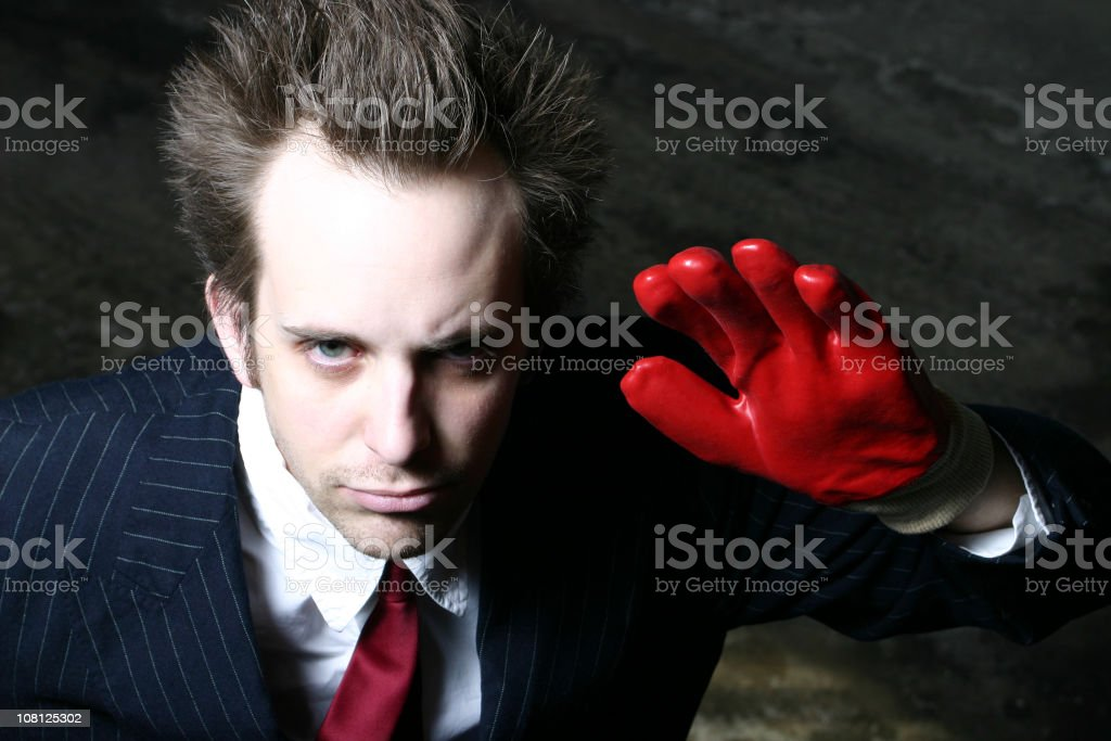Man Wearing Red Glove and Waving royalty-free stock photo