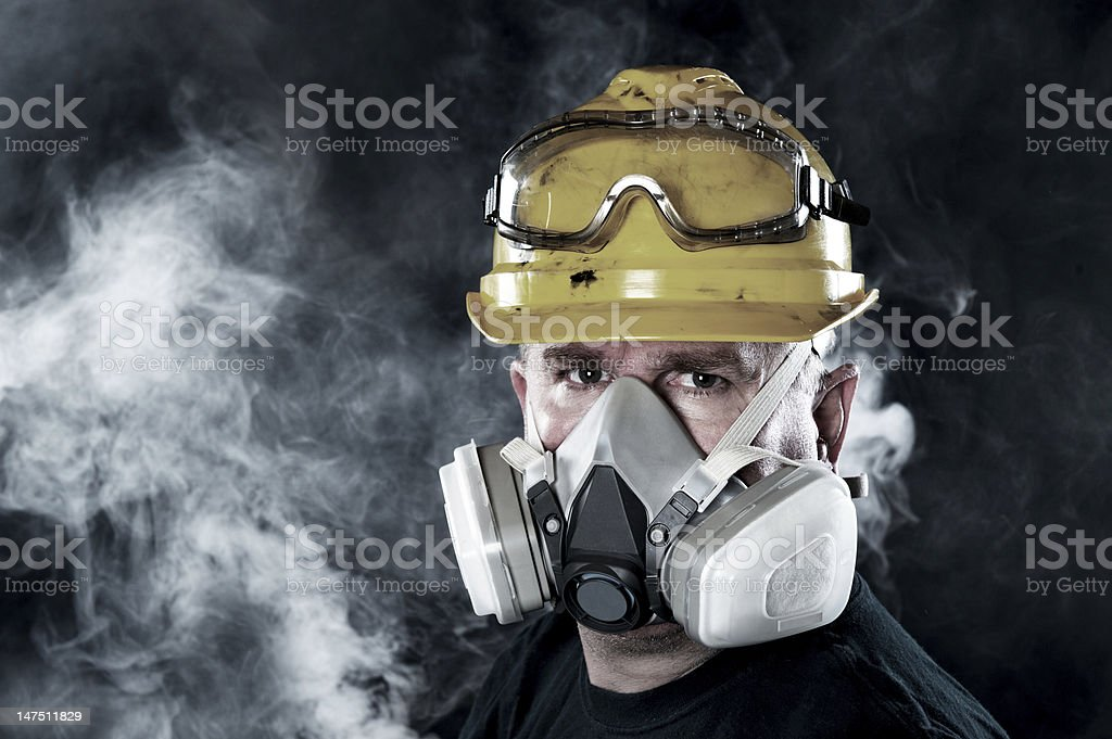 Man wearing respirator stock photo