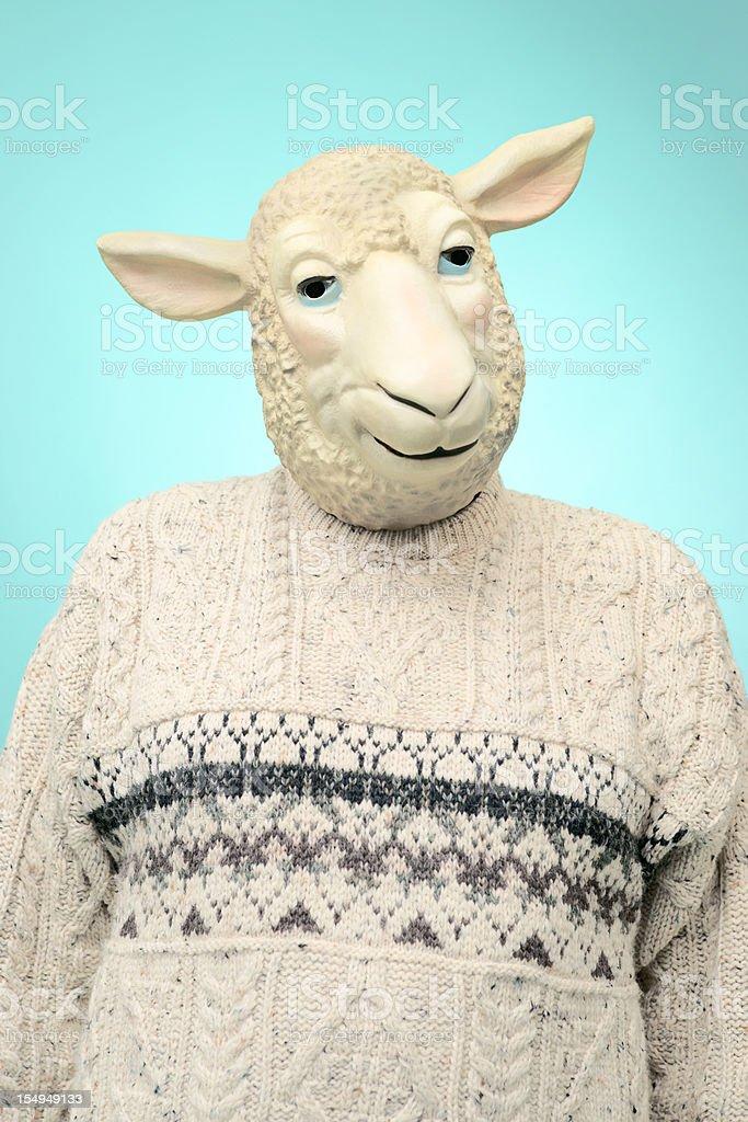 Man wearing sheep mask and Aran sweater, portrait. royalty-free stock photo