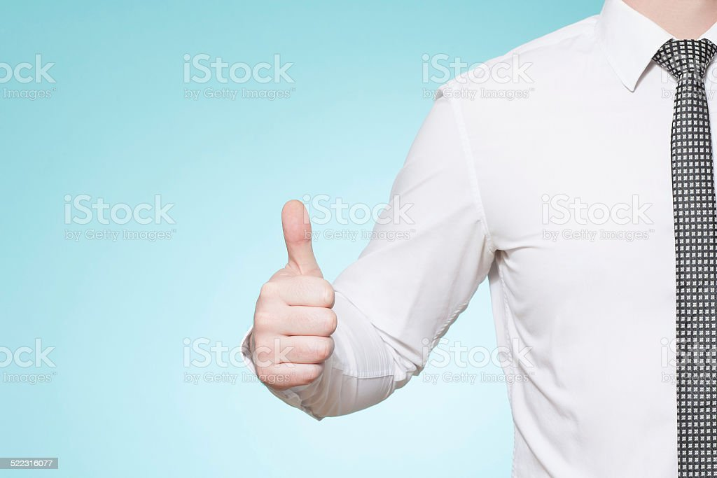 Man wearing shirt and tie thumbs up stock photo