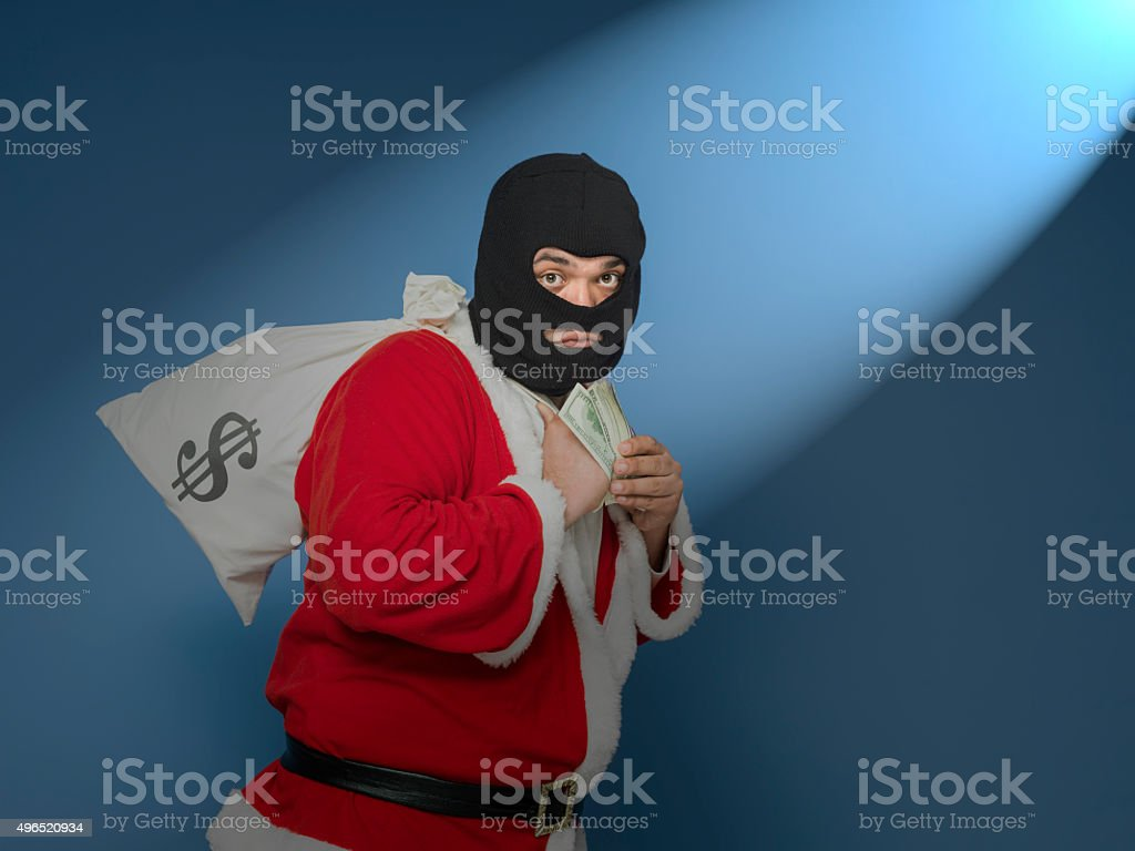Man Wearing St Nicholas Costume And Mask Stealing Money Bag stock photo