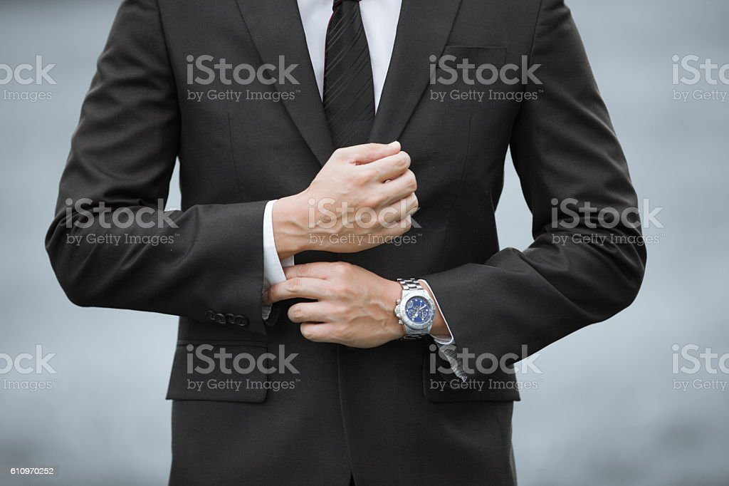 Man wearing suit and watch stock photo