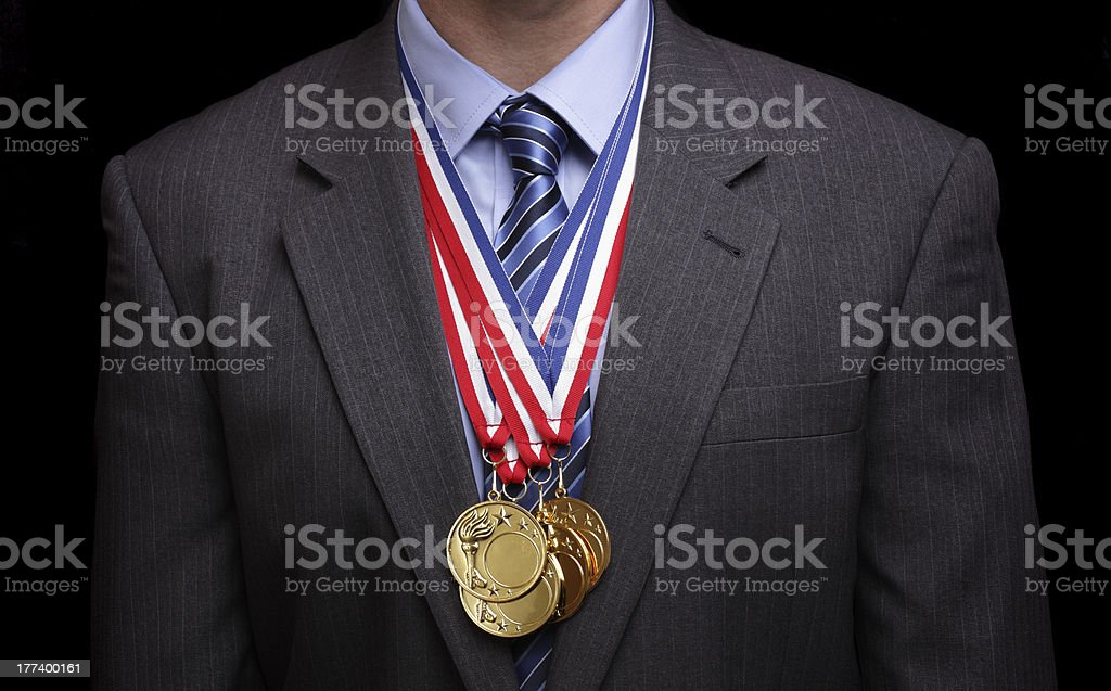 Man wearing suit jacket and gold medals stock photo