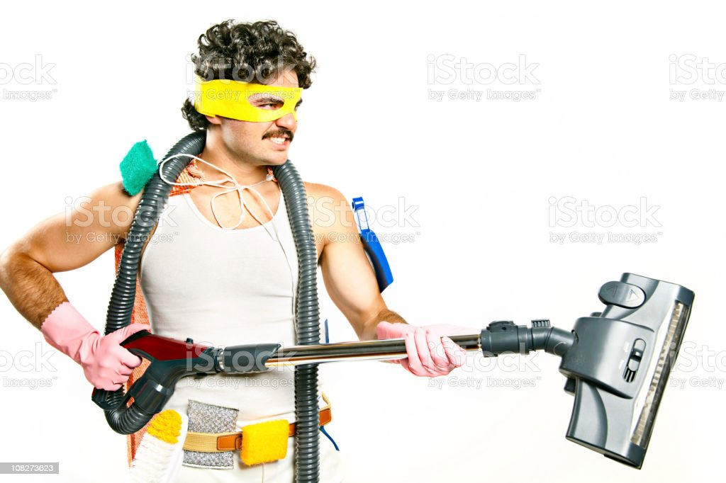 Man Wearing Superhero Mask Holding Vacuum and Cleaning Supplies royalty-free stock photo
