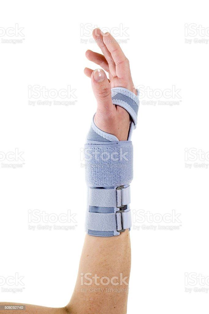 Man Wearing Supportive Wrist Brace in Studio. stock photo