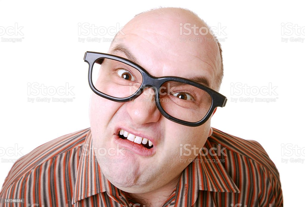 A man wearing thick-framed glasses looking confused royalty-free stock photo