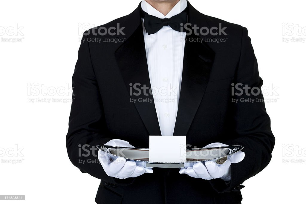Man wearing tuxedo with a blank invitation royalty-free stock photo