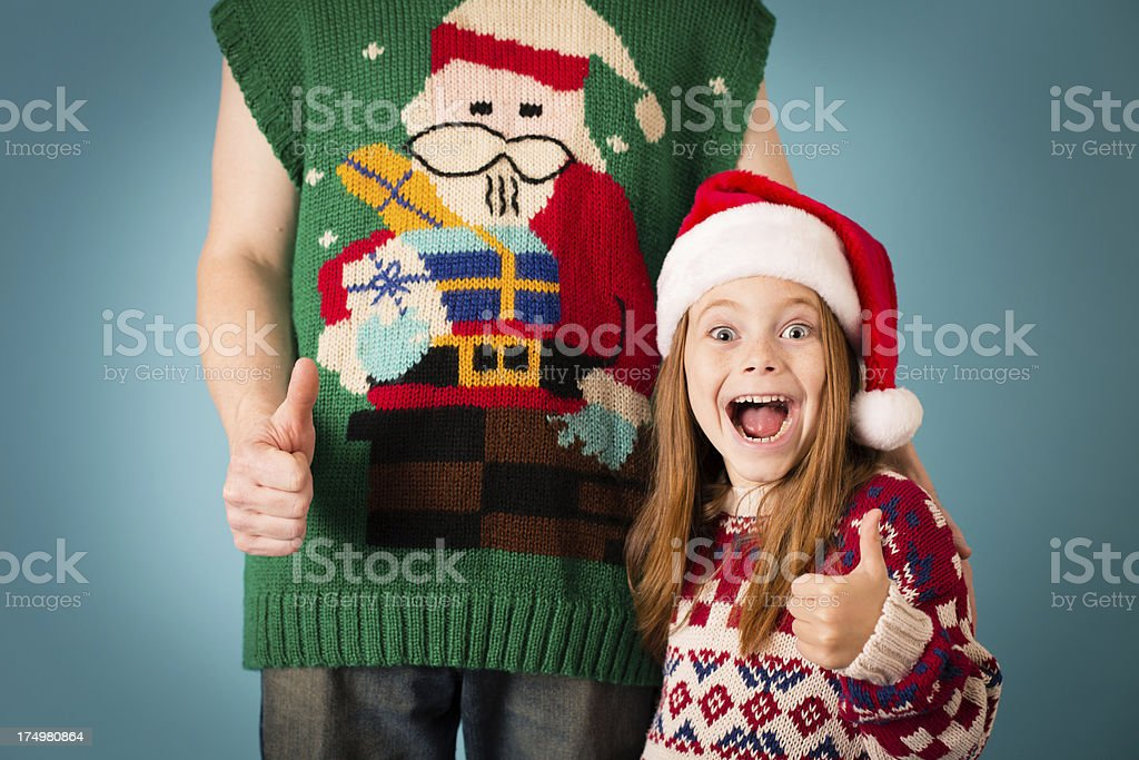 Man Wearing Ugly Sweater With LIttle Girl royalty-free stock photo