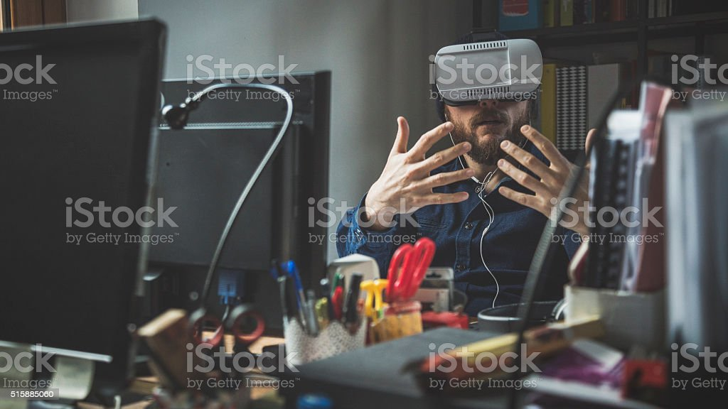 Man wearing virtual reality headset at the office stock photo