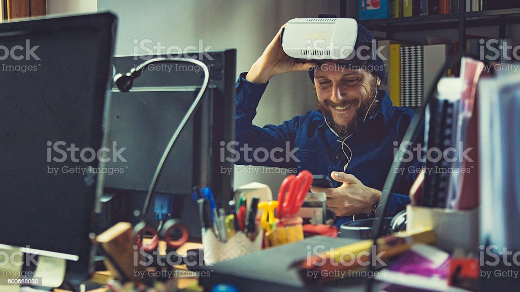 Man wearing virtual reality VR headset at office stock photo